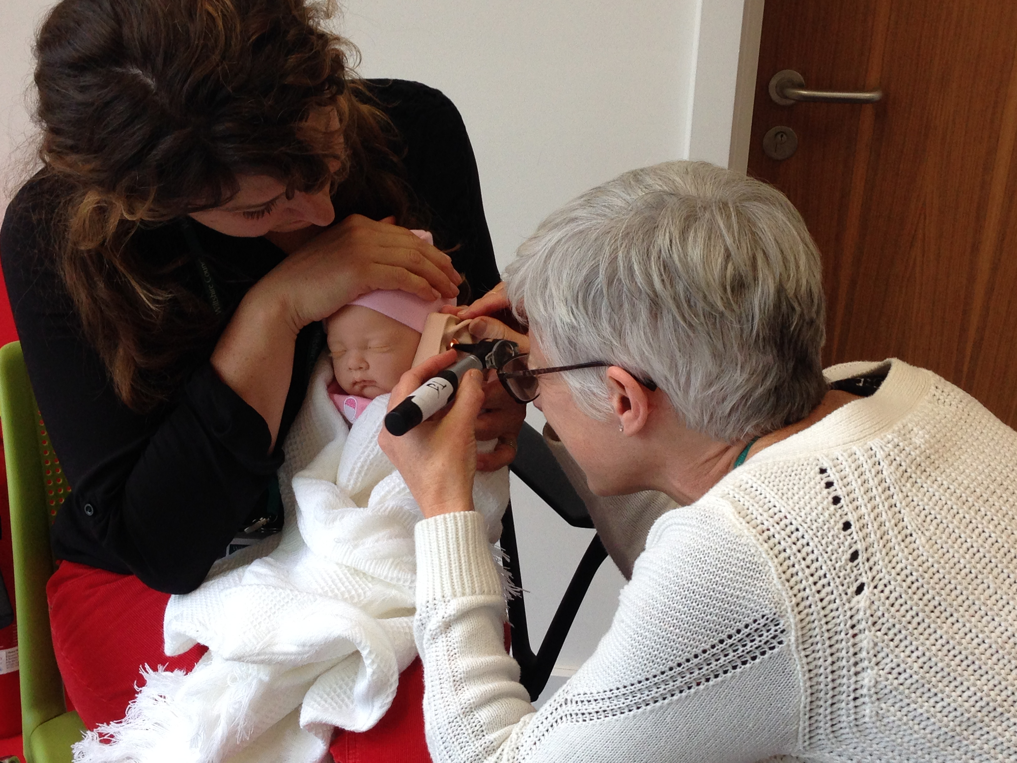 Otoscopy on a newborn baby
